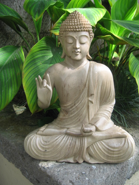 Hand carved buddha from hibiscus wood