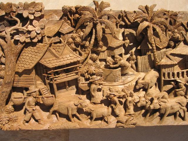 Hand carved thai village scene teak panel