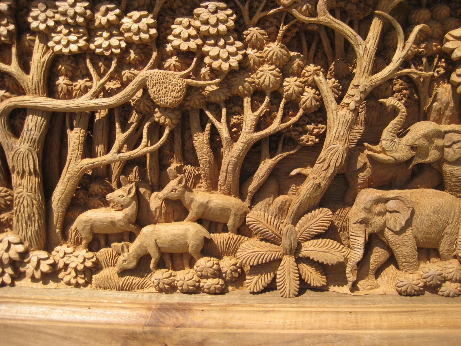 Hand carved elephants scene teak panel